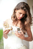 Beautiful girl look at the gift — Stock Photo