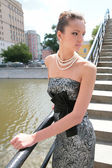 Luxurious brunette on bridge — Stock Photo