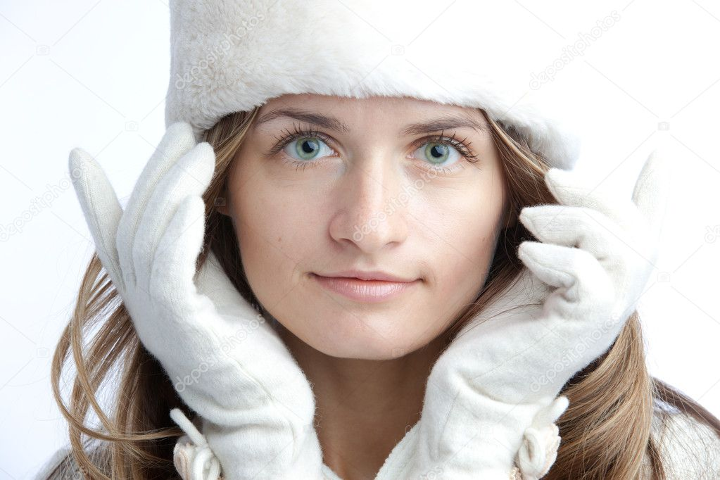 Portrait of the girl with green eye in white glove and winter hat from fur — Stock Photo #1187031