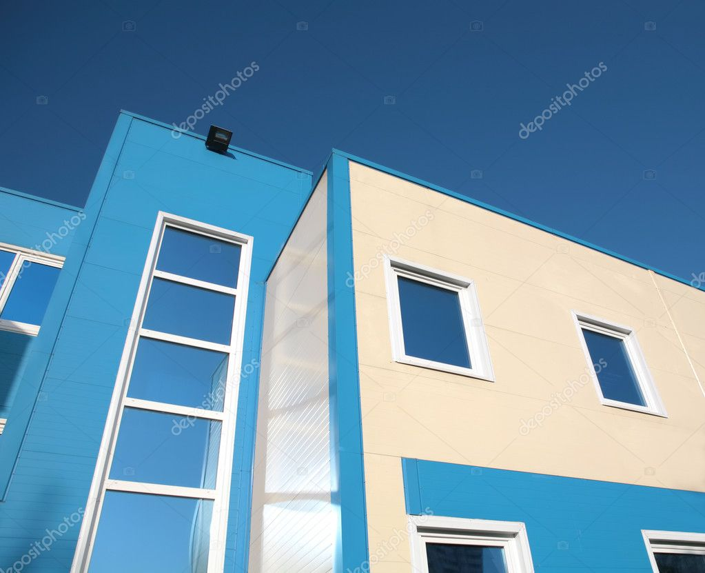 Fragment of the new building on background blue sky — Stock Photo #1187575