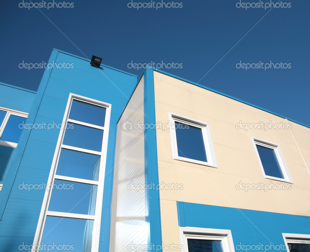 Fragment of the new building on background blue sky — Foto de Stock   #1187575