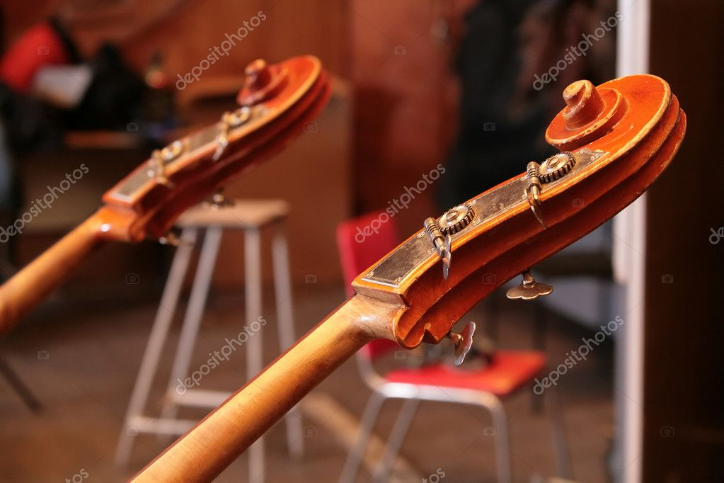 Vintage, music instruments, fragment of the old bass viol — Stock Photo #1187815