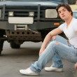 Stock Photo: Man and black jeep