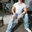Youth in torn jeans — Stock Photo