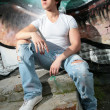 Young man on steps — Stock Photo