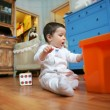 Baby plays in the room, soft focus - Stock Photo