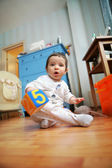 Adorable infant plays in the room — Stock Photo