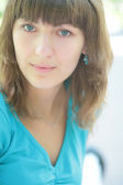 Green-eyed girl in blue t-shirt — Stock Photo