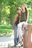 Two beautiful girls in city-park — Stock Photo