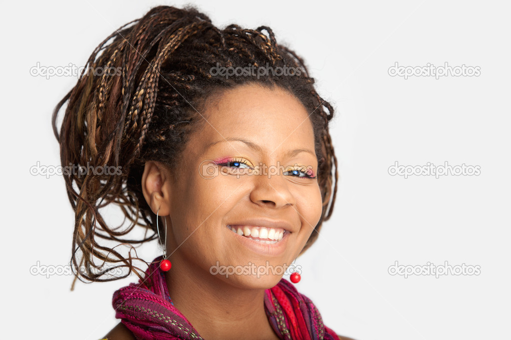 Smiling young african woman with exotic hairstyle  Stok fotoraf #1356630