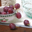 grape and ceramic dishes — Stock Photo