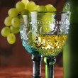 Golden wine in old-time goblet - Stock Photo