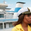 Girl in captain cap - Stock Photo