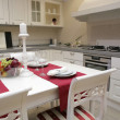 Modern kitchen in classical style - Stock Photo