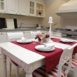 Stock Photo: Served table in interior of the kitchen