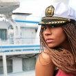 Black girl in the white captain cap — Stock Photo