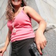Stok fotoğraf: Woman with big black gun