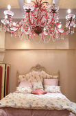 Bedroom with red chandelier — Stock Photo