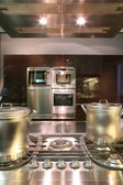 Interiors of kitchen with gas fryer — Stock Photo