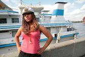 Serious girl in captain cap — Stock Photo