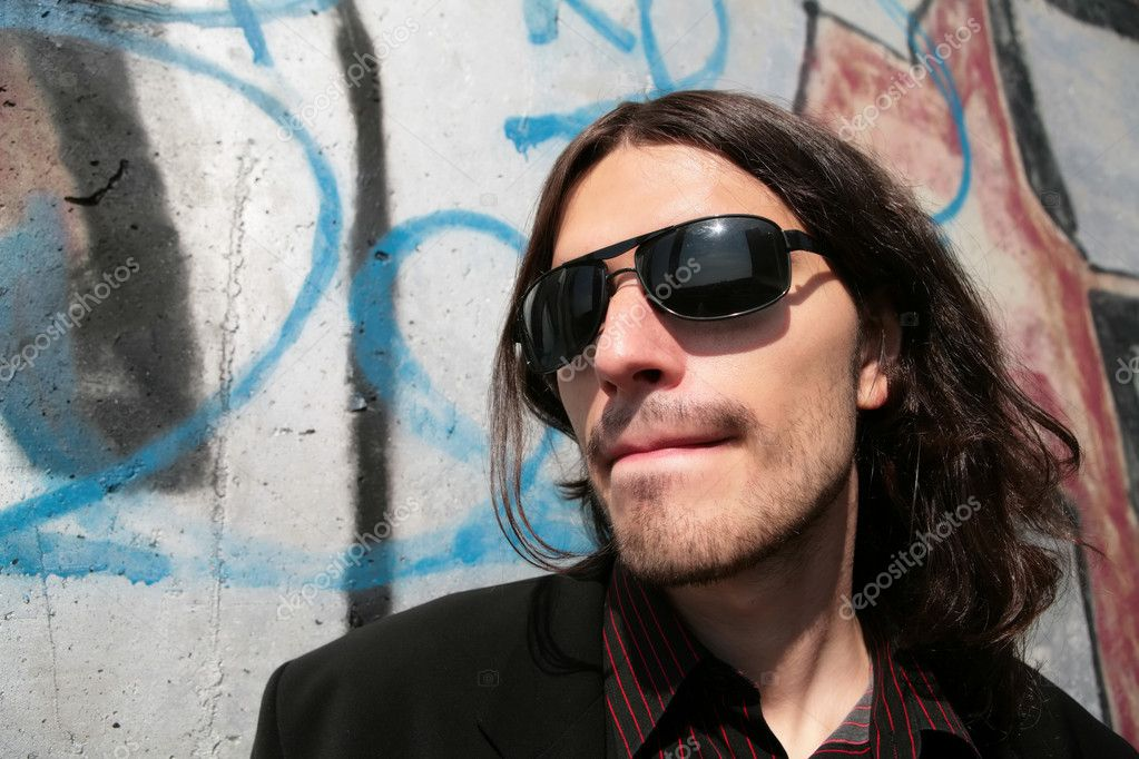 Close-up portrait of the young man in black sunglasses in gangster style — Stock Photo #1375089