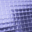 Metallic net in glass - Stock Photo