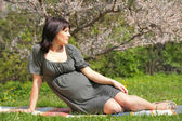 Pregnant woman is dreaming about future — Stock Photo