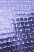 Metallic net in glass — Stock Photo