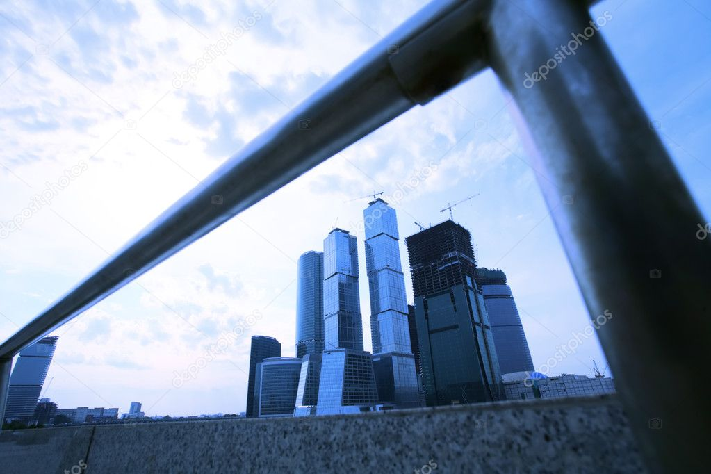 Evening type of skyscrapers of the Moscow from under quay banisters   Stock Photo #1383376