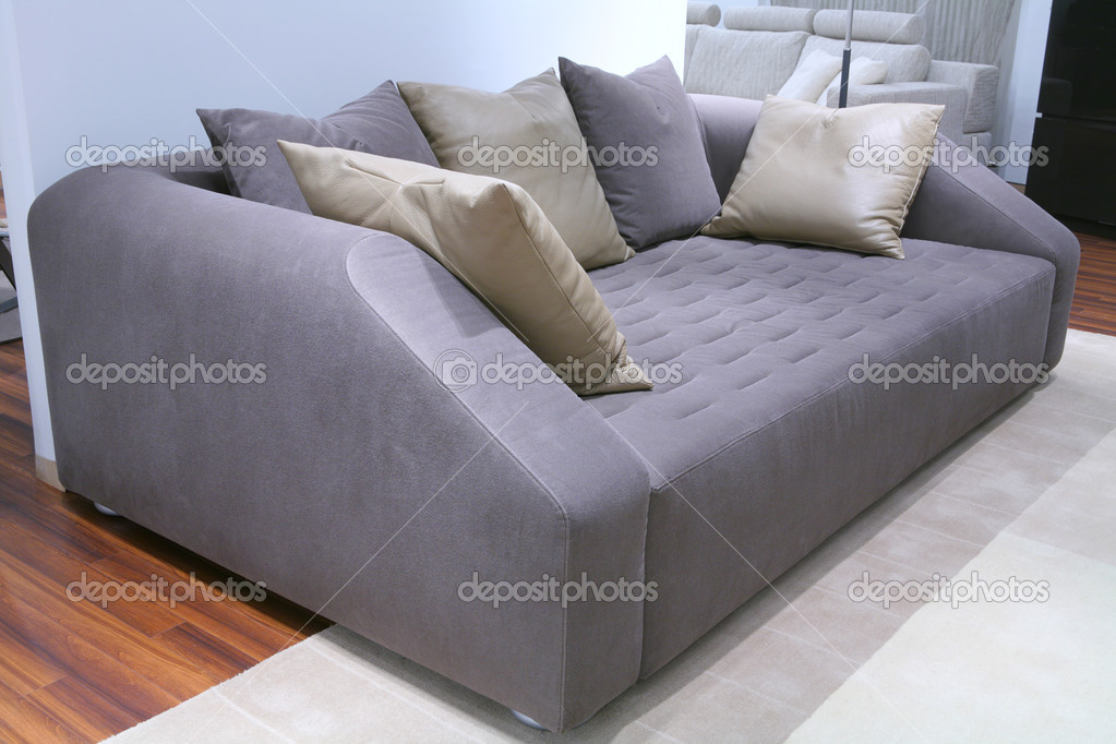 Fragment of the interior, furniture, velour sofa with leather pillow — Stock Photo #1387398