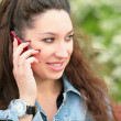 Royalty-Free Stock Photo: Brunette speaks on telephone