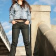 Brunette in jeans jacket - Stock Photo