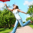 Girl jumps with umbrella — Stock Photo
