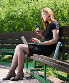 Businesswoman drink coffee — Stock Photo