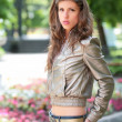 Girl in silvery jacket — Stock Photo #1405892