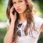 Girl speaks on phone — Stock Photo