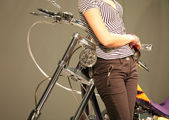 Motorcycle and Feminine Figure — Stock Photo