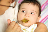 Infant eats the puree — Stock Photo