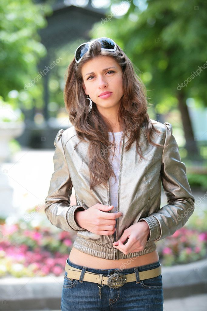 Beautiful girl in silvery jacket and sunglasses in park  Stock Photo #1405900