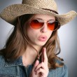 Cowgirl with imaginative gun - Stock Photo