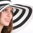 Beautiful smiling girl in striped hat — Stock Photo #1410372