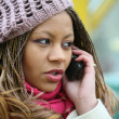 Woman is talking on mobile phone - Stock Photo