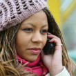 Girl is talking on telephone — Stock Photo