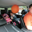 Family in salon of the car — Stock Photo