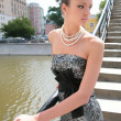 Luxurious brunette on bridge - Stock Photo