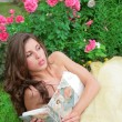Princes in white-golden gown with book - Stock Photo