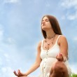 Pregnant woman is meditating — Stock Photo #1415436