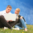 Young man and girl blonde with laptop — 图库照片