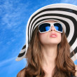 Beautiful girl in striped hat — Stockfoto