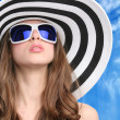 Glamourous girl in hat and sunglasses - Stock Photo